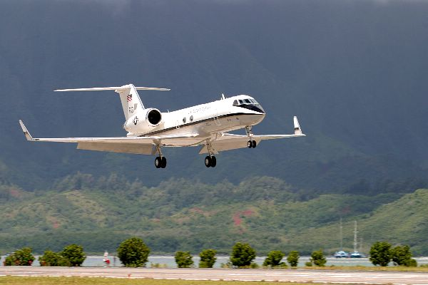 "C-20G Gulfstream - Marine Corps Air Base Kaneohe, Hawaii (Apr. 21, 2004) - A C-20G Gulfstream aircraft attached to the ""Windjammers"" of Fleet Logistics Support Squadron Five One (VR-51) makes a final approach for a ""touch and go"" landing during a local training flight. Since February 2003, VR-51 has deployed C-20G Gulfstream aircraft to the Persian Gulf region in support of Operation Enduring Freedom (OEF) and Operation Iraqi Freedom (OIF). The primary mission of the squadron is to transport the staff of U. S. Central Command (CENTCOM) around the region. VR-51 completed 183 missions, flying 1826 hours while transporting 2595 passengers and 117,250 pounds of cargo during that time spent in the Persian Gulf region. U.S. Navy photo by Photographer"