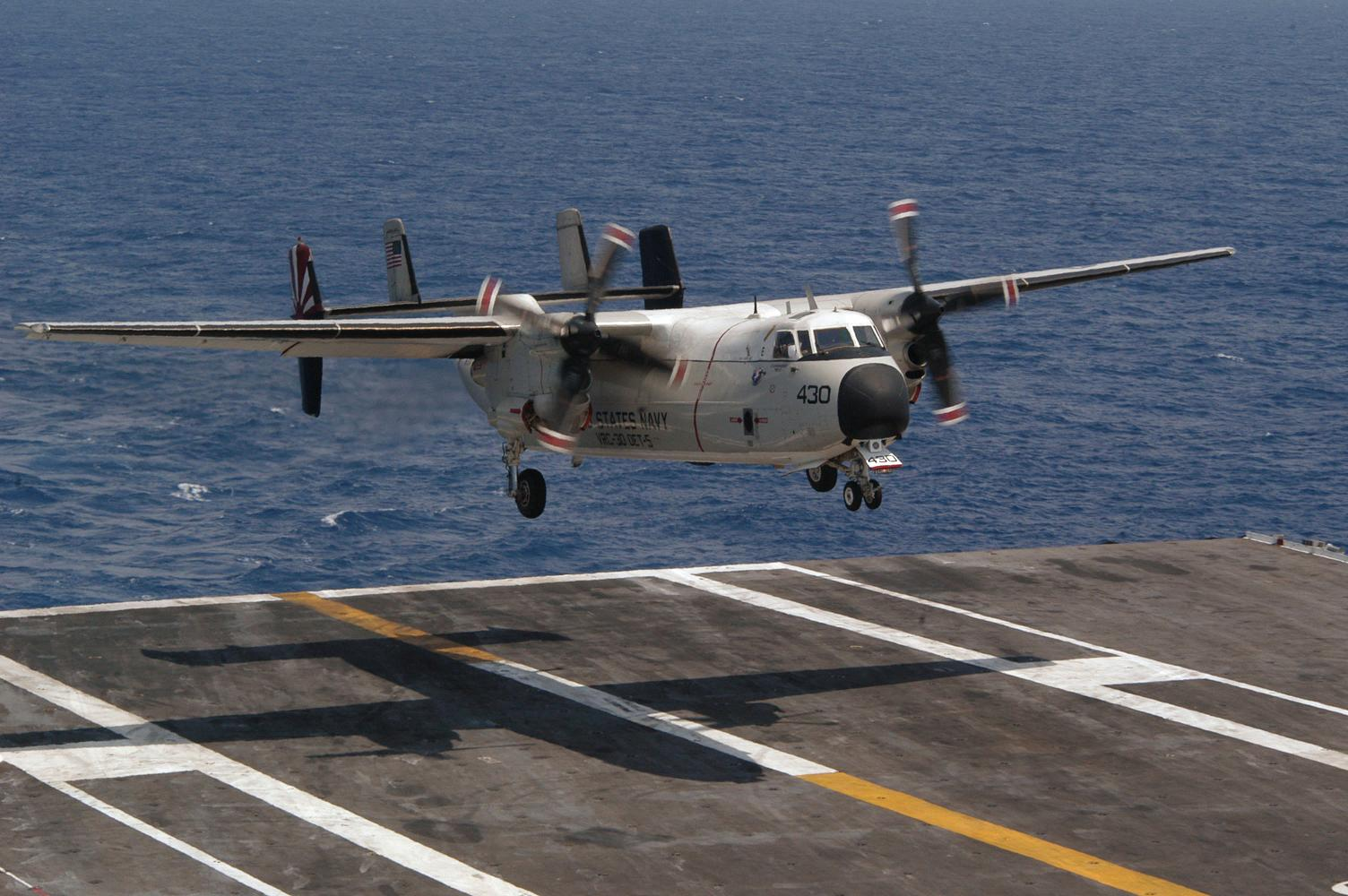 C-2A Greyhound - Pacific Ocean (July 20, 2004) - A C-2A Greyhound assigned to the ?Providers ? of Fleet Logistic Squadron Three Zero (VRC-30), lands on the flight deck of USS Kitty Hawk (CV 63) during Carrier Qualifications (CQ), in the western Pacific Ocean. Kitty Hawk is one of seven carrier strike groups (CSGs) involved in Summer Pulse 2004. Summer Pulse 2004 is the simultaneous deployment of seven carrier strike groups (CSGs), demonstrating the ability of the Navy to provide credible combat capability across the globe, in five theaters with other U.S., allied, and coalition military forces. Summer Pulse is the Navy?s first deployment under its new Fleet Response Plan (FRP). Kitty Hawk demonstrates power projection and sea control, as the world