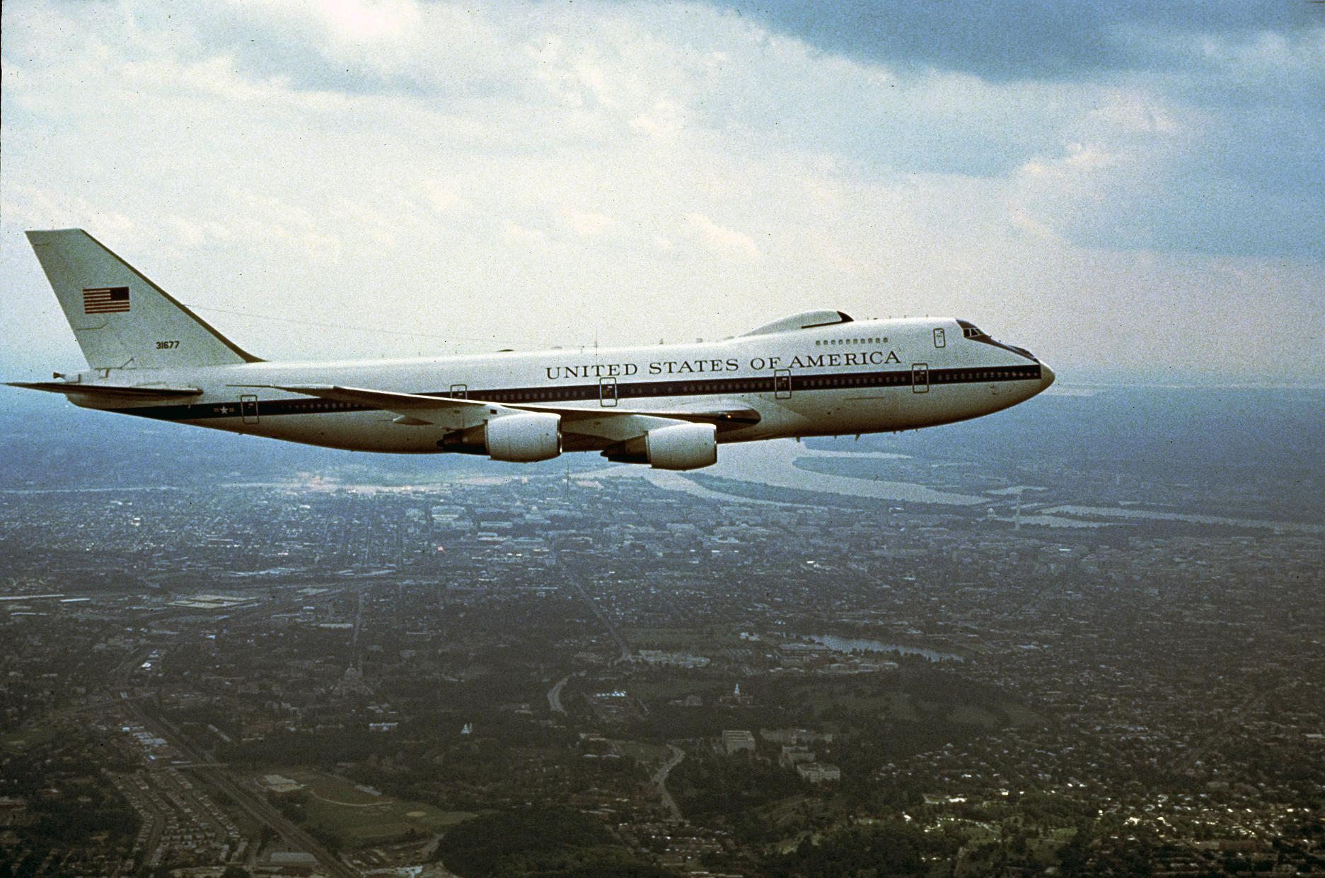 E-4B - E-4B flying over a city.