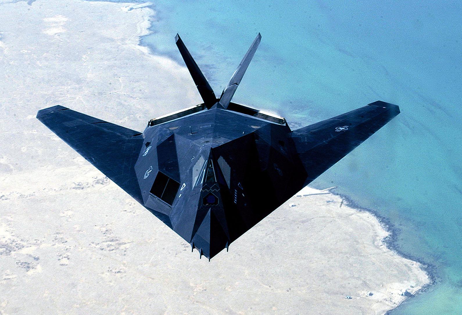 F-117A Nighthawk - F-117A Nighthawk flying over the coastline.