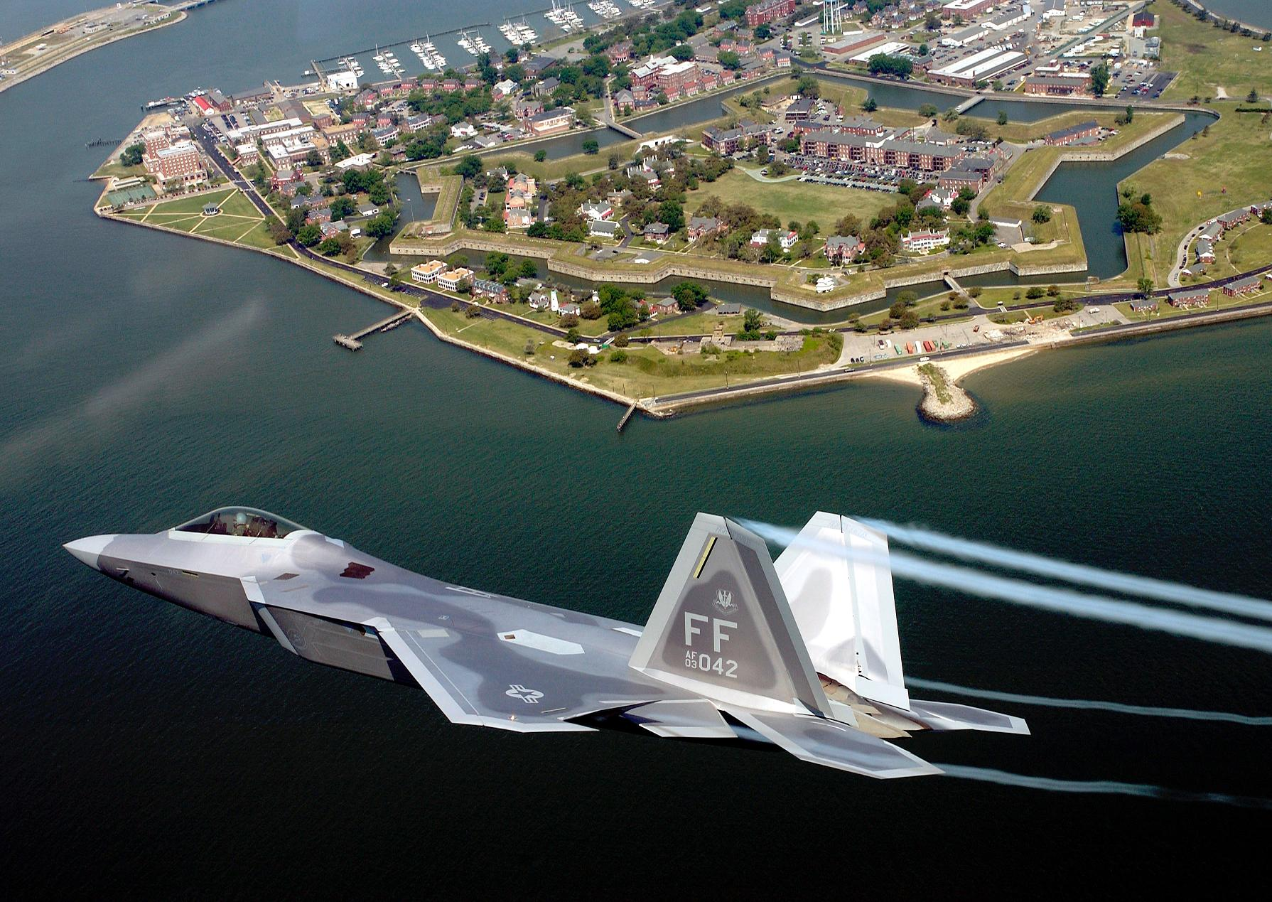 F-22A Raptor - F-22A Raptor banking right over a coast.