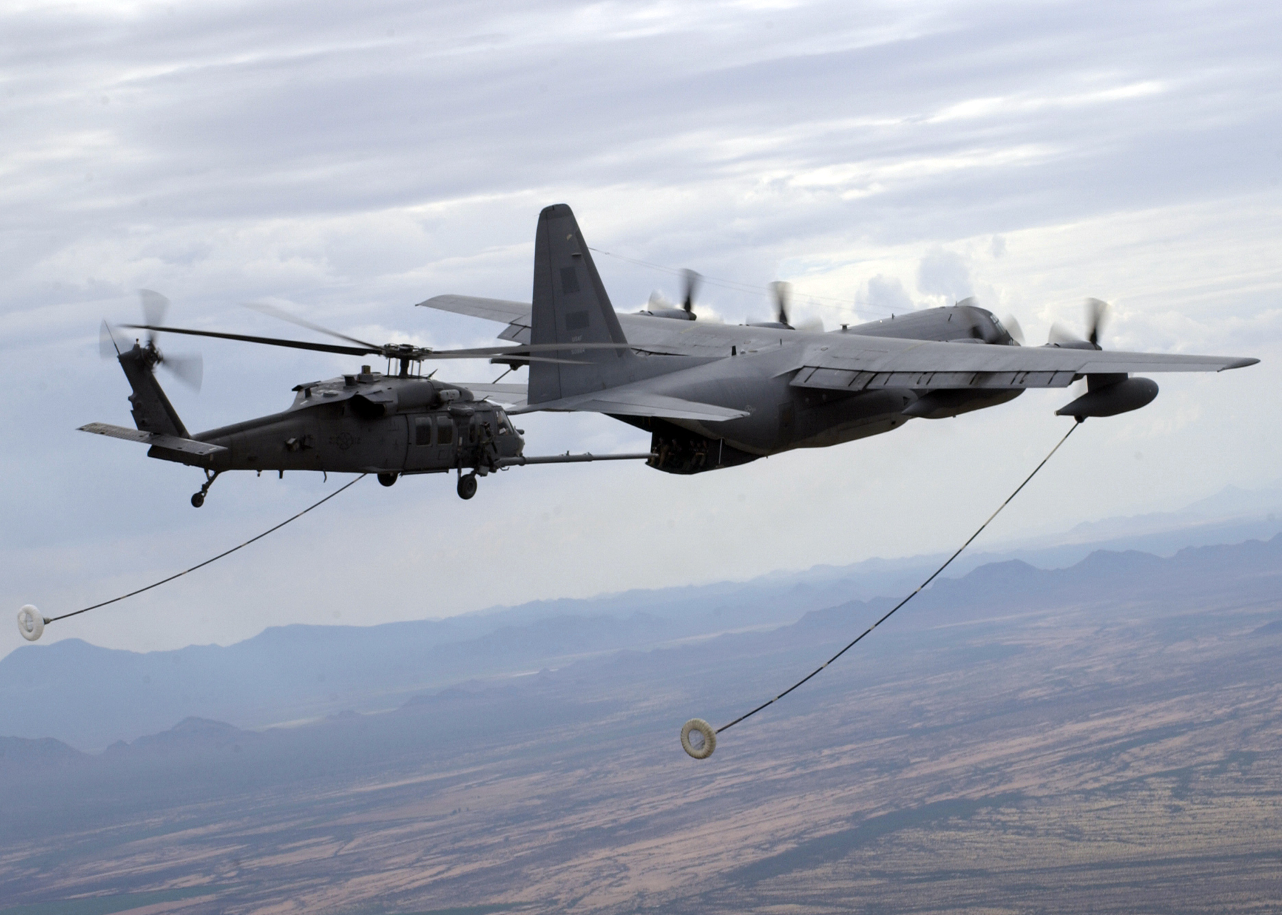 HC-130P - HC-130P refueling a chopper.