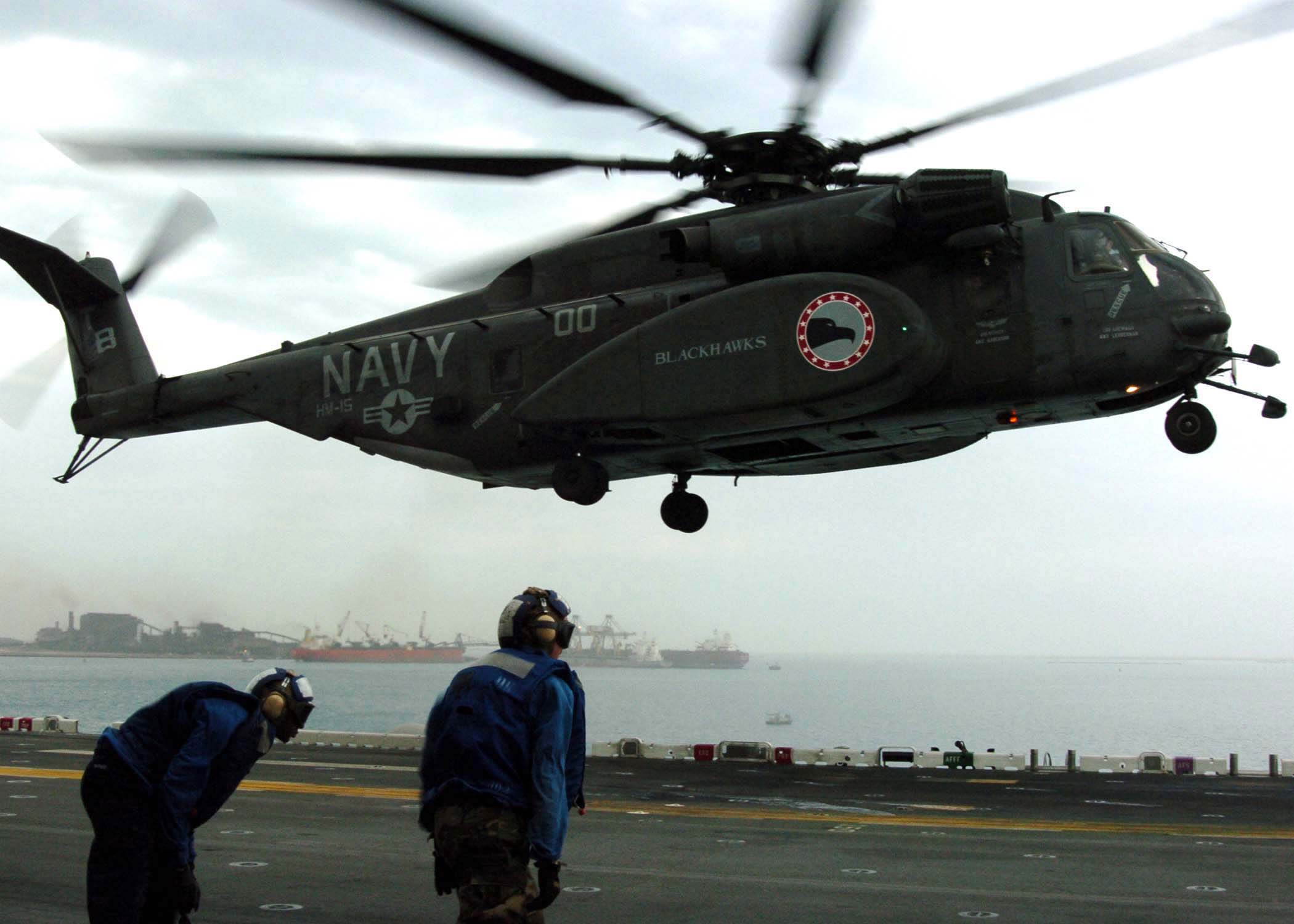 "MH-53E Sea Dragon - Persian Gulf (Jan. 10, 2005) - An MH-53E Sea Dragon helicopter, assigned to the ""Blackhawks"" of Helicopter Mine Countermeasures Squadron Fifteen (HM-15), lands on the flight deck aboard the amphibious assault ship USS Essex (LHD 2). Essex is undergoing preparations to support Operation Unified Assistance, the humanitarian operation effort in the wake of the Tsunami that struck South East Asia. U.S. Navy photo by Photographer"