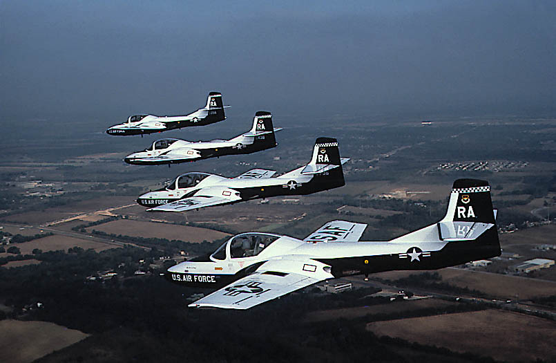 T-37 Tweet - Four T-37 Tweets flying in formation.