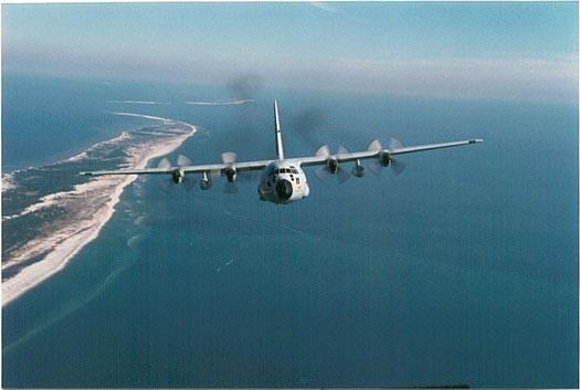 WC-130 Hercules - WC-130 Hercules flies near the coast.