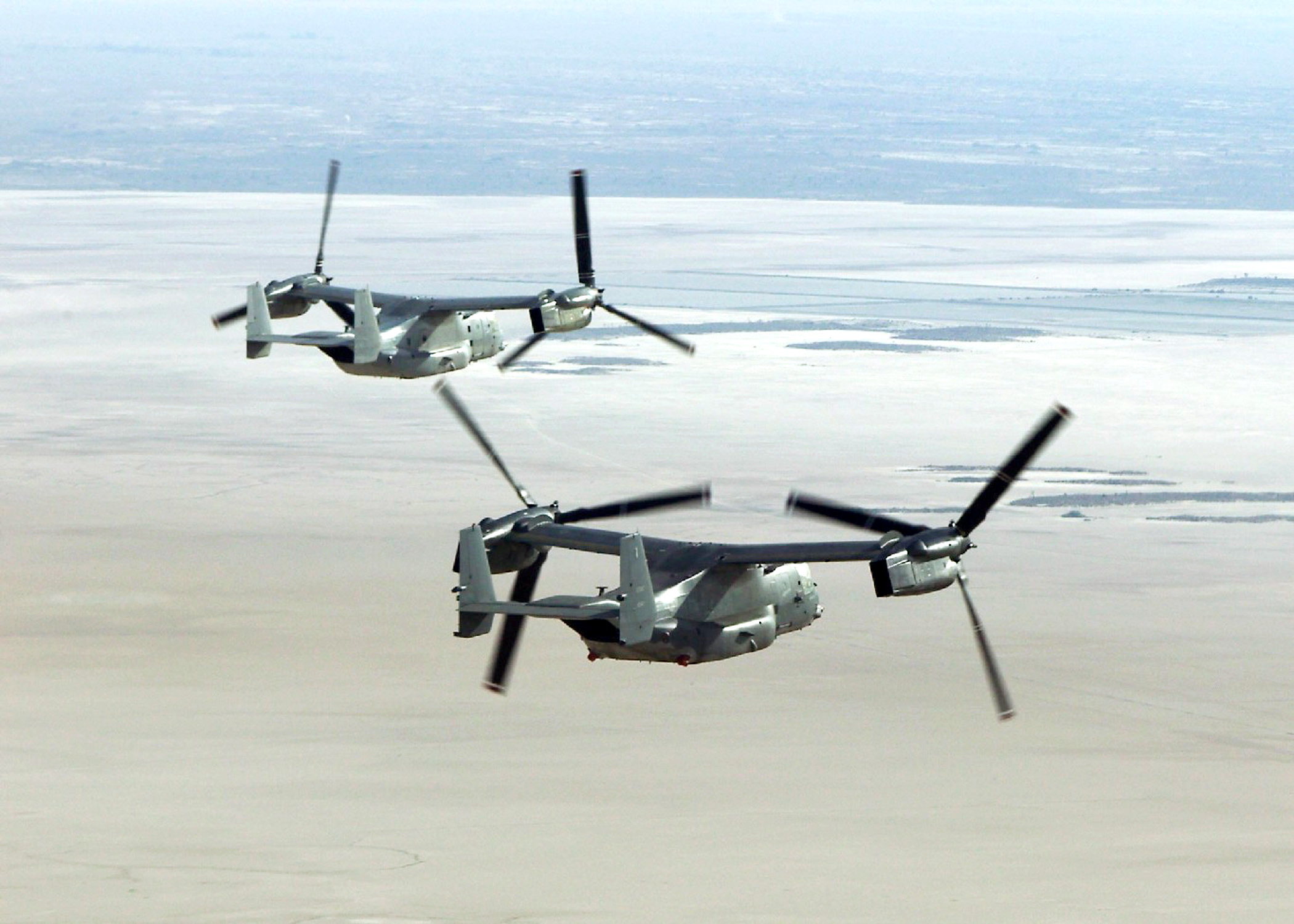 CV-22 Osprey - Two CV-22 Ospreys flying side by side.