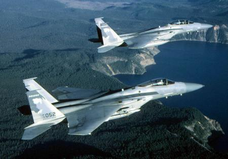 F-15 Eagle - Two F-15 Eagles fly side by side.