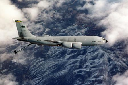 KC-135 Stratotanker - KC-135 Stratotanker flying among the clouds.