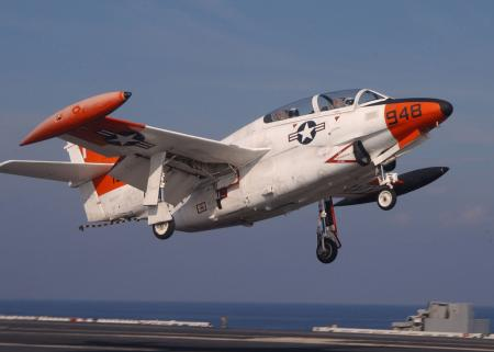 T-2C Buckeye - Aboard USS Harry S. Truman (CVN 75) Jul.16, 2003 -- A T-2C Buckeye assigned to Fixed Wing Training Squadron Nine (VT-9) performs a touch and go on the flight deck of USS Harry S. Truman (CVN 75). This is the last time the T-2C Buckeye will be used to train student pilots aboard aircraft carriers. Truman is conducting Carrier Qualifications (CQ) and an ammo off load, on the Eastern seaboard of the United States. U.S. Navy photo by Photographer