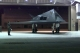 F-117A Nighthawk - F-117A Nighthawk parked near a hangar.